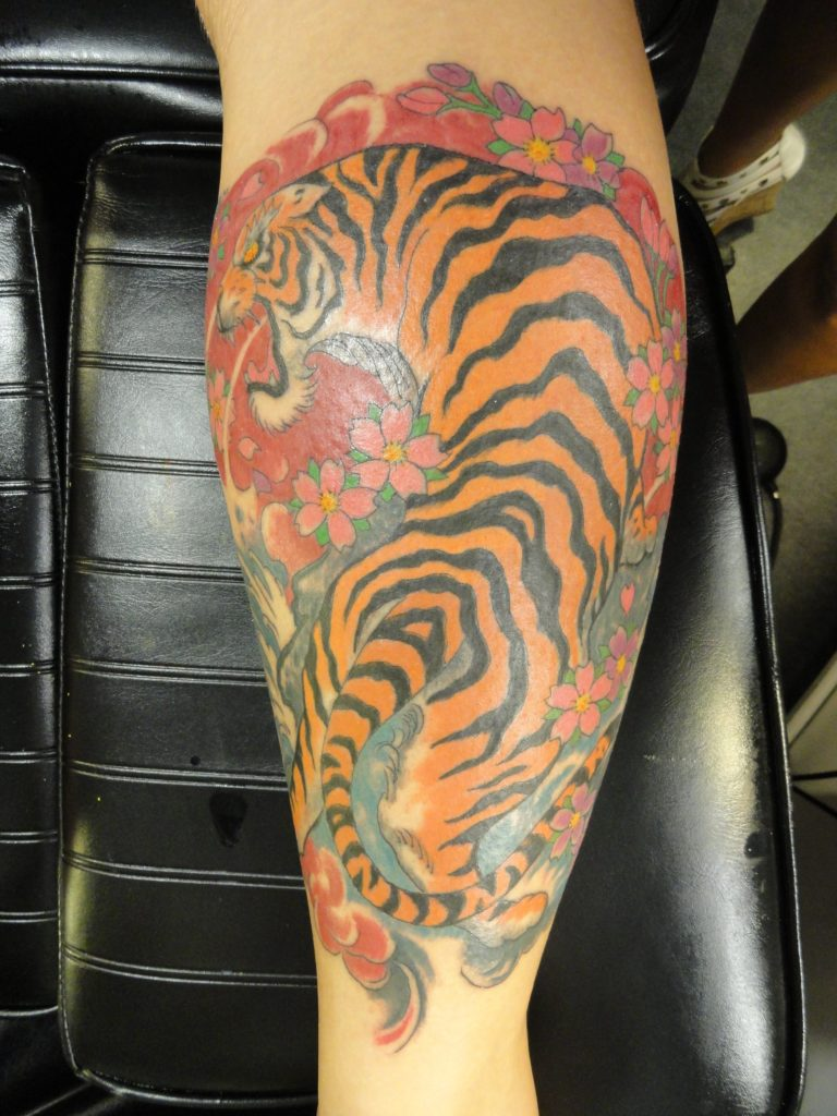 oriental tiger on calf muscle