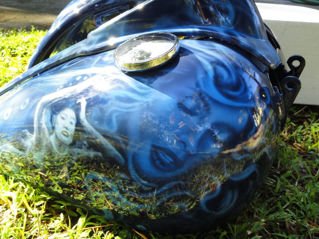 mermaid face on tank