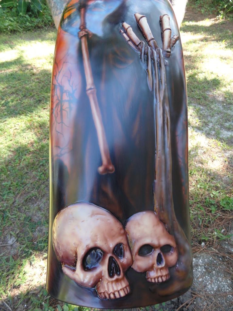 grim reaper with skulls